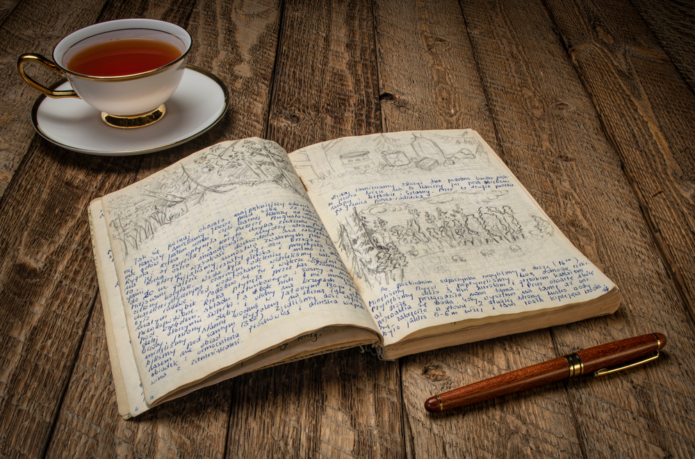 Cup of hot tea and memories - vintage travel journal with handwriting and pencil sketches (property release attached) from 1974 paddling expedition.