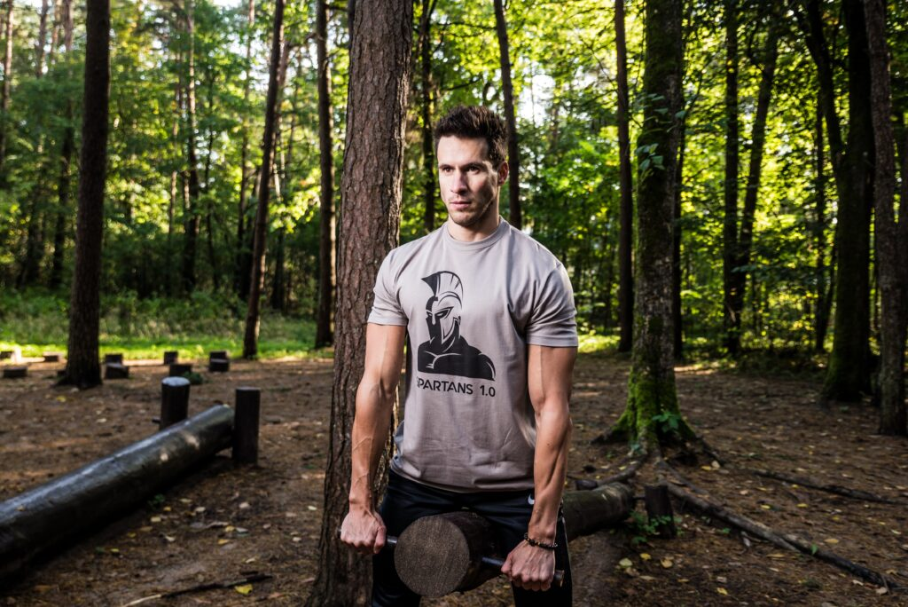 """Photo of men's workout in the forest. This is photo session of new t-shirt collection """"SPARTANS 1.0"""". Idea is to show men's difficult challenges, discipline, superb physical condition, determination, courage and constant self-development. Because this is what Ancient Spartan warriors was about. Hope you will love this moment :)"""